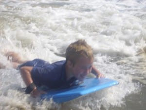 Sam body boarding at Chapel