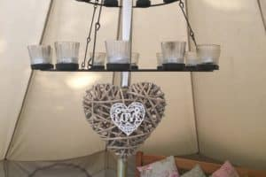 The double tea light chandelier in our glamping bell tent