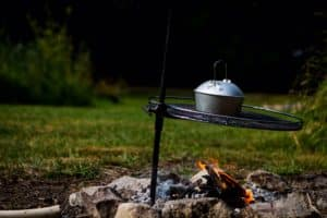 The camping kettle is over the campfire