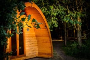 Our glamping camping pod in the evening sunshine with the oak and cherry trees in the picture