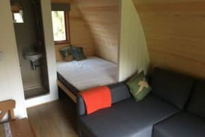 The deluxe en suite glamping pod with double bed, double sofa bed and en suite wet room